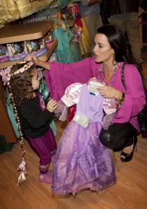 Kyle Richards and daughter trying on Rapunzel costume